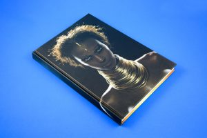 I AM IMAN is a book published by Booth-Clibborn Editions in 2001, with fantastic typography, gatefolds, diecuts, interactive elelments and frames commisioned and realized by Jonathan Barnbrook. It contains an introduction by David Bowie and photographs by Anna Leibowitz, Ellen Von Unwerth, Sante D'Orazio and Michel Comte among the others.